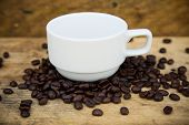 image of coffee crop  - Coffee beans background on wooden - JPG