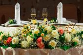 image of wedding feast  - Decorated wedding table for newlyweds with two glasses of champagne - JPG