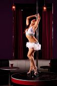 foto of pole dance  - pretty young sexy stripper in the club - JPG