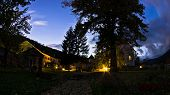 image of serbia  - 12.century Studenica monastery yard during evening prayer, UNESCO world heritage site in Serbia ** Note: Soft Focus at 100%, best at smaller sizes - JPG