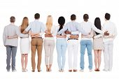 foto of bonding  - Full length rear view of group of diverse people bonding to each other while standing against white background - JPG