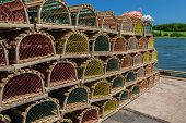pic of lobster trap  - Stack of lobster traps on a wharf in rural Prince Edward Island - JPG
