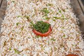 picture of buffet  - Closeup detail of rice with vermicelli dish on display at an oriental restaurant buffet - JPG