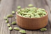 pic of ayurveda  - Green cardamom super food ayurveda asian aroma spice flavour in a wooden bowl on vintage background - JPG