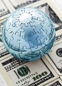 stock photo of 100 dollars dollar bill american paper money cash stack  - World globe on american dollars World economy concept - JPG