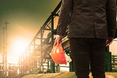 pic of industrial safety  - engineering man and safety helmet standing against beautiful light sun shine in heavey petrochemical industry estate - JPG