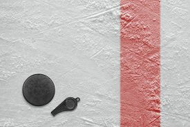 stock photo of referee  - Referee whistle and washer on the hockey rink - JPG