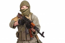 stock photo of ak-47  - insurgent wearing keffiyeh with AK 47 gun isolated on white - JPG