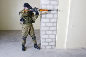 pic of sniper  - mercenary sniper with sniper rifle inside the building - JPG