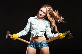 image of independent woman  - Sexy seductive woman holding axes choppers - JPG
