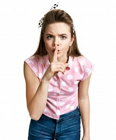 picture of gesture  - Girl holding her finger to her lips in a gesture for silence keep it quiet gesture  - JPG