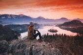 Traveling Young Woman Looking On Sunset On Bled Lake, Slovenia, Europe poster