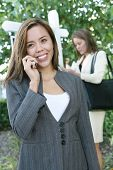 stock photo of clientele  - A beautiful young real estate agent woman on the phone - JPG