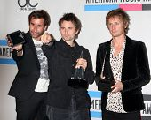 LOS ANGELES - NOV 21:  Muse - Christopher Wolstenholme, Matthew Bellamy and Dominic Howard in the Pr