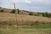 Leaning Wooden Electrical Poles With Wires 2 poster