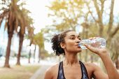 Athlete Drinking Water During Morning Jog poster