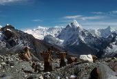 stock photo of sherpa  - Sherpanis carrying climbing loads over 17000 feet. Chyungma Pass Khumbu Himalaya Nepal ** Note: Slight blurriness, best at smaller sizes - JPG