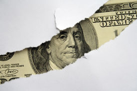 image of one hundred dollar bill  - Large hole in the white paper and one hundred dollar bill in it - JPG