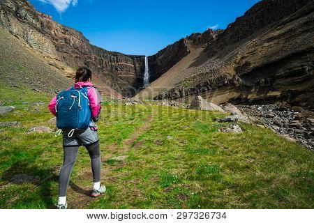 poster of Traveler Hiking At Hengifoss Waterfall, Iceland.