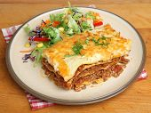 Beef lasagna with salad