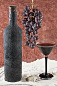 Old Bottle Of Wine With A Full Beaker Of Wine, Bunch Of Grapes And Cork