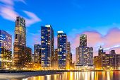 Sunset at Chicago Skylines building at Chicago downtown along Lake Michigan in Chicago City Illinois poster