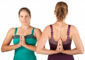 stock photo of namaskar  - Two women in forward and backward namaskar salutation poses - JPG