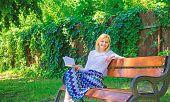 Lady Enjoy Poetry In Garden. Enjoy Rhyme. Woman Happy Smiling Blonde Take Break Relaxing In Garden R poster