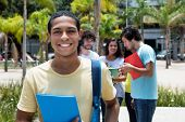 Happy Egyptian Scholarship Student With Group Of International Students Outdoor On Campus Of Univers poster