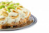 Part Of Pavlova Cake With Banana And Kiwi Over Metal Dish