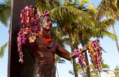 stock photo of waikiki  - Statue of famous surfer Duke Kahanamoku on Waikiki beach in Hawaii - JPG