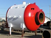 picture of pressure vessel  - pressure vessel with freshly painted exterior in red  - JPG