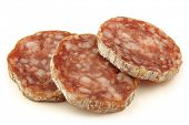 spicy Italian salami sausage slices on a white background poster