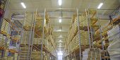 Boxes On High Shelves At Industrial Warehouse On Production Plant Drone View. Large Warehouse Of Fin poster