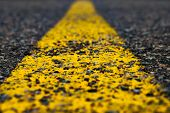 Road Marking Line With Yellow Paint On Asphalt. Marking The Motorway. Close-up poster