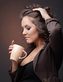 Beauty girl with coffee cup