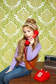 stock photo of babbler  - kid girl retro hip vintage talking busybody with red telephone - JPG