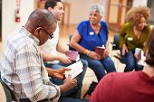 People Attending Bible Study Or Book Group Meeting In Community Center poster