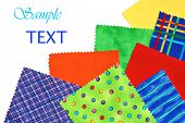 Colorful cotton fabric swatches (used for sewing, quilting, applique, and crafts) on white backgroun