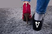 Personal Has A Lady`s Boot On One Foot, And On The Other A Male Boot.the Person Has A Third-gender S poster