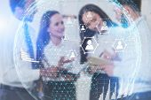 Blurred Diverse Team Of Business People Working In Office With Double Exposure Of People Network And poster