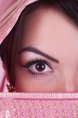 stock photo of yashmak  - Beautiful young womanish eye in pink yashmak - JPG
