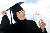 Happy graduate muslim student with diploma