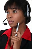 Afro-American woman wearing a headset