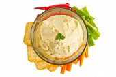 stock photo of humus  - Bowl of hummus dip with vegetables and crackers - JPG