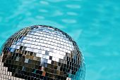 Disco ball beside blue swimming pool water
