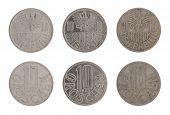Old Austrian ten groschen coins isolated on white