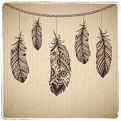 stock photo of dream-catcher  - Ethnic feather heart on the cardboard background - JPG