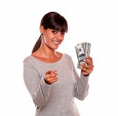 Smiling Young Woman With Money Looking At You