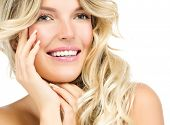 portrait of attractive  caucasian smiling woman blond isolated on white studio shot  toothy smile fa